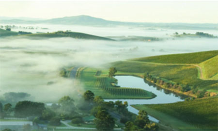 Waterway with hills and mist in the background