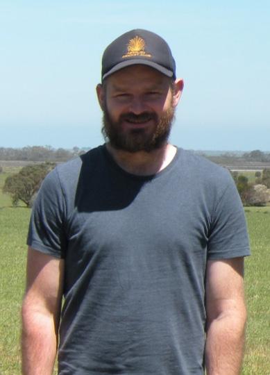 Nicholas Blandford with farm paddocks in background