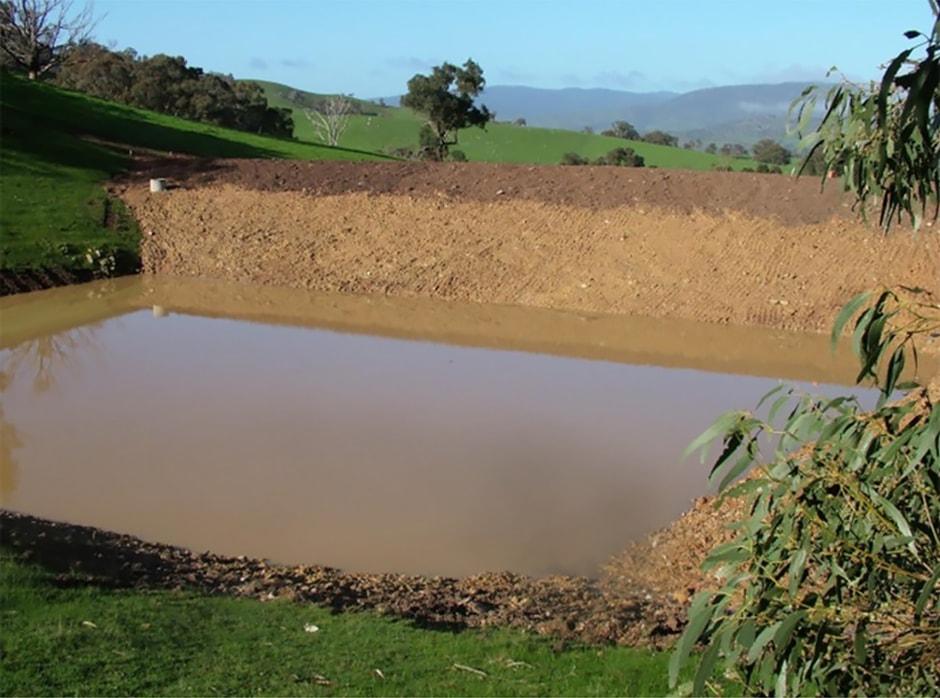 Square dam cut into hill side